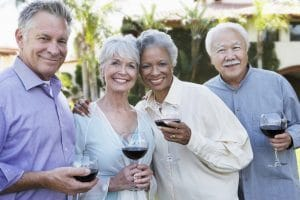 Couples enjoying red wine